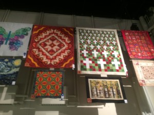 Another view of the quilts hanging up above