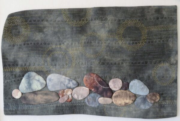 rocks appliqued on linen, hand-embroidery running stitch, circles and lines fmq