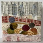 Landscape, machine pieced and quilted, hand applique and hand embroidery